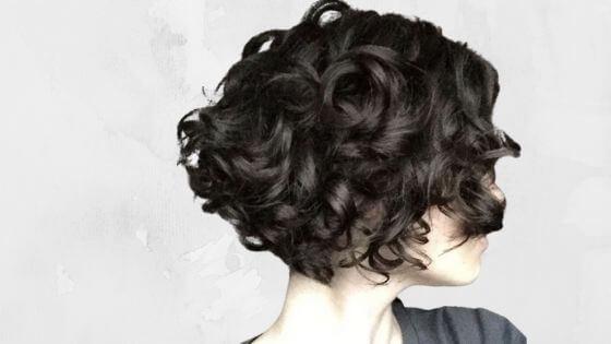 Asymmetrical pixie cut curly hair